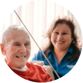 ApexCare caregiver working with a client.