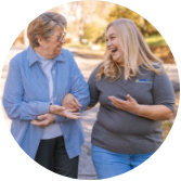 ApexCare caregiver walking with a client.