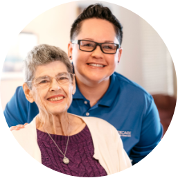 One of ApexCare's caregivers smiling with a client.