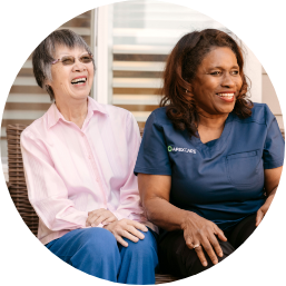 One of ApexCare's caregivers laughing with a client.